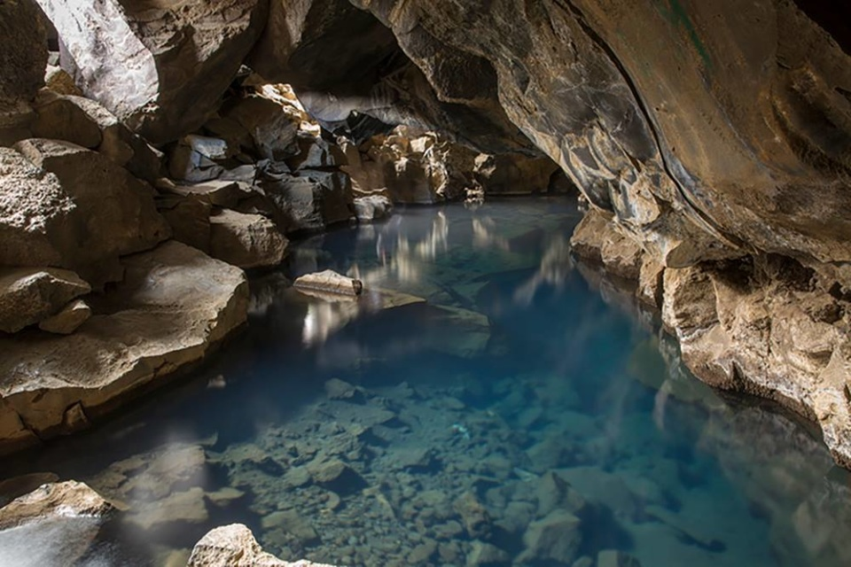 Hot Spring In Cave Iceland