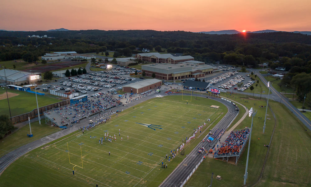 The Sun Sets Over The Model High School Blue Devils